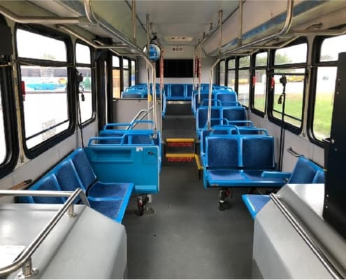 Wide shot of the interior of a chartered Voigt bus