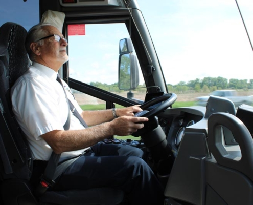 Voigt Bus driver seen from the side mid drive