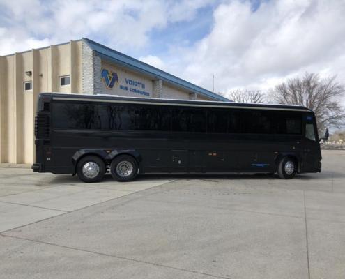 Left side of an all black Voigt bus